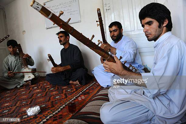 Afghan music students play the sitar in Herat on August 21 2013 The Central Asian nation has an ancient tradition of songs built on its rich culture...
