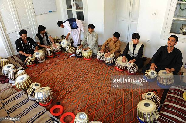 Afghan music students play traditional drums in Herat on August 21 2013 The Central Asian nation has an ancient tradition of songs built on its rich...