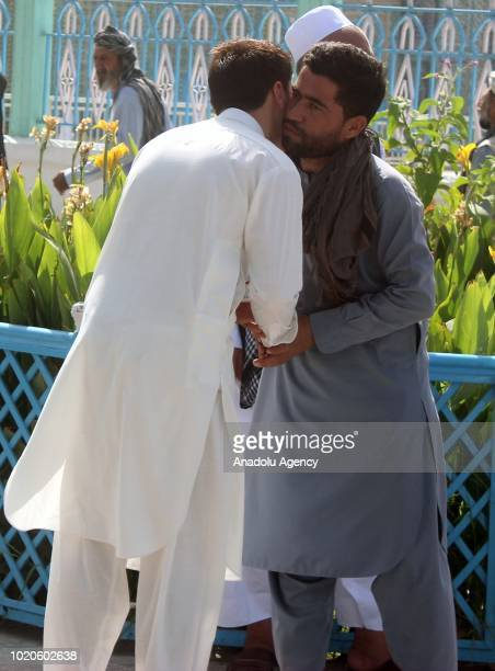 Afghan muslims congratulate each other's eid after performing the Eid AlAdha prayer at RawzaiSharif mosque in MazariSharif Afghanistan on August 21...