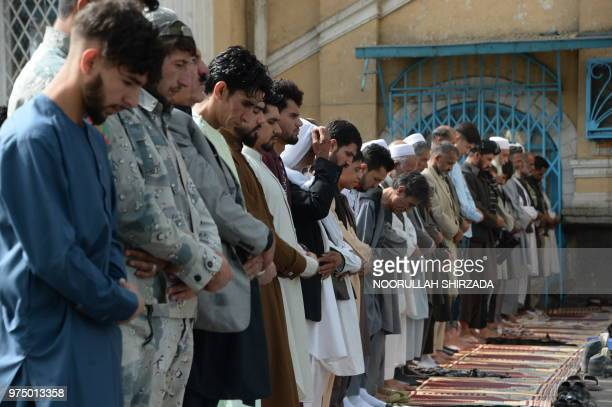 Afghan Muslims offer prayers at the start of the Eid alFitr holiday which marks the end of Ramadan at the Shahe Do Shamshira mosque in Kabul on June...