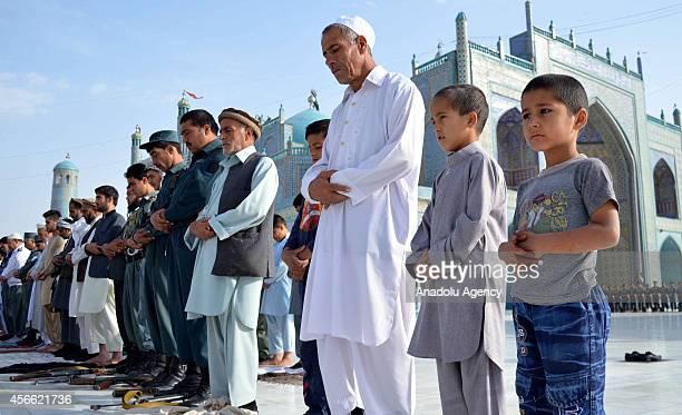 Afghan Muslims perform El alAdha prayer at the Blue Mosque in MazariSharif Afghanistan on October 4 2014