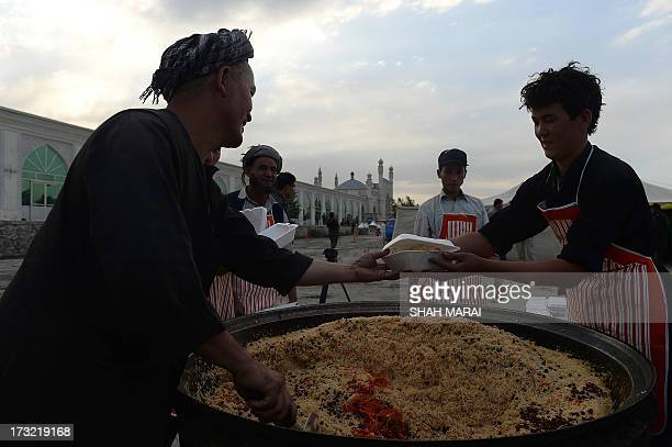 Afghan Muslims prepare the free evening meal during Iftar at the Eidga mosque in Kabul on July 10 during the Islamic month of Ramadan Throughout the...