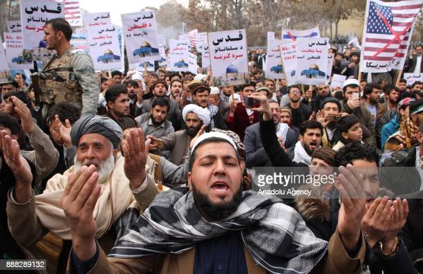 Afghan Muslims shout slogans as they stage a protest against U.S. President Donald Trump's announcement to recognize Jerusalem as the capital of...