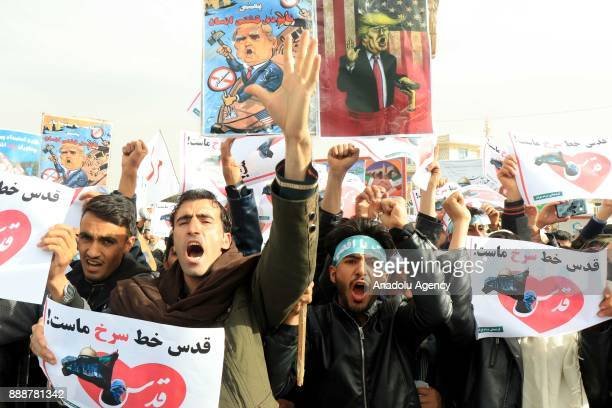 Afghan Muslims shout slogans as they stage a protest against US President Donald Trump's announcement to recognize Jerusalem as the capital of Israel...