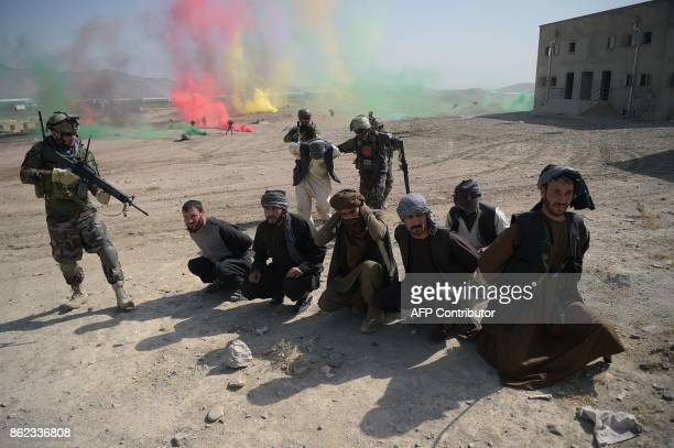 Afghan National Army commandos arrest men pretending to be Taliban fighters during a military exercise at the Kabul Military Training Centre on the...