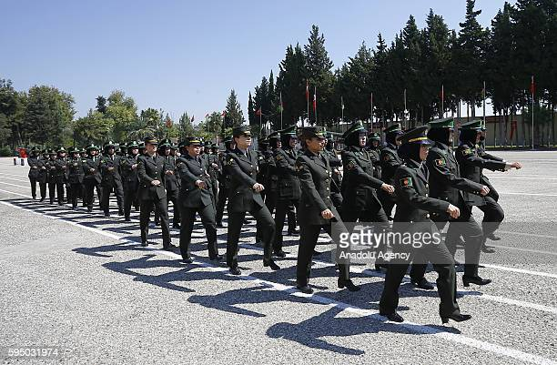 Afghan National Army forces' female sergeant and officer candidates march, during the graduation ceremony, after basic military training by Turkish...