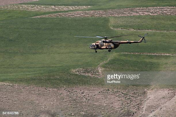 Afghan National Army helicopters are flying in the mountainous region of Badakhshan in northeast Afghanistan on 15 June 2106.