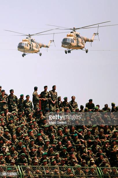 Afghan National Army Russian-made helicopters fly past during a ceremony to commemorate the anniversary of the fall of a Soviet-installed regime on...