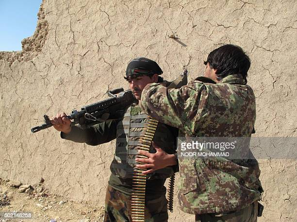 Afghan National Army soldiers adjust their equipment in Helmand on December 21 2015 Clashes intensified on December 21 as the Taliban pressed an...