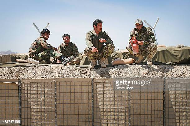 Afghan National Army soldiers eat lunch at an outpost along the KabulGardez Highway on March 31 2014 near Pule Alam Afghanistan Soldiers at the...