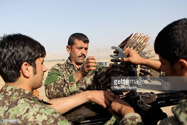 Afghan National Army soldiers fix a machine gun during a training session with German Bundeswehr soldiers on October 12 2010 in Feyzabad Afghanistan...