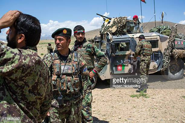 Afghan National Army soldiers from the 7th Kandak prepare to move out during a joint operation setting up an Afghan Forward Operating Base with U.S....