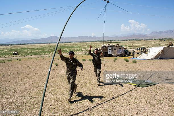 Afghan National Army soldiers from the 7th Kandak set up a radio antennae May 6, 2013 during a joint operation establishing an Afghan Forward...