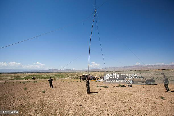 Afghan National Army soldiers from the 7th Kandak set up an antennae May 6, 2013 during a joint operation establishing an Afghan Forward Operating...