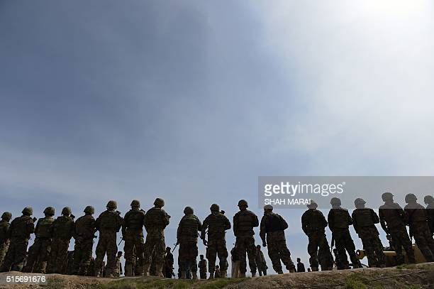 Afghan National Army soldiers gather in DandeGhori district in Baghlan province on March 15 following weeks of heavy battles to recapture the area...