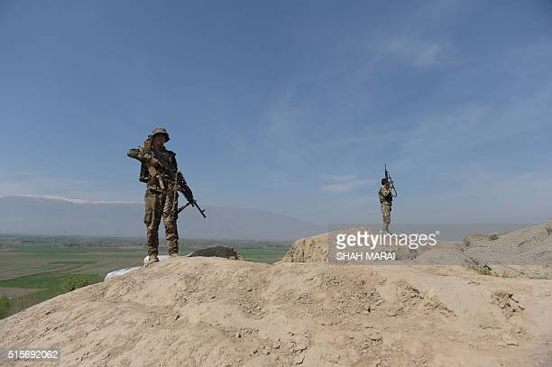 Afghan National Army soldiers keep watch in DandeGhori district in Baghlan province on March 15 following weeks of heavy battles to recapture the...