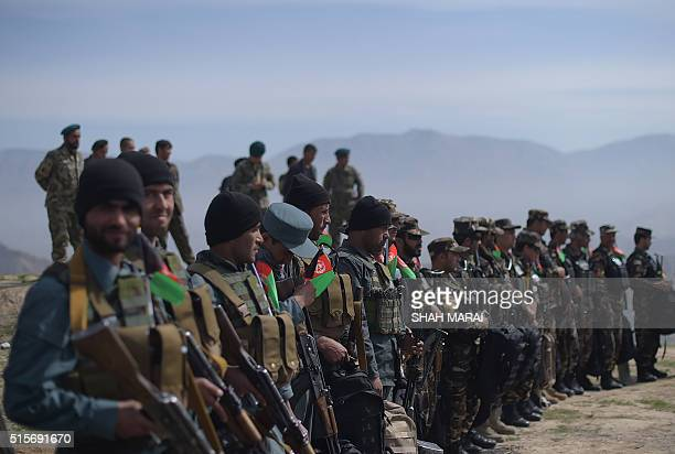 Afghan National Army soldiers line up in DandeGhori district in Baghlan province on March 15 following weeks of heavy battles to recapture the area...