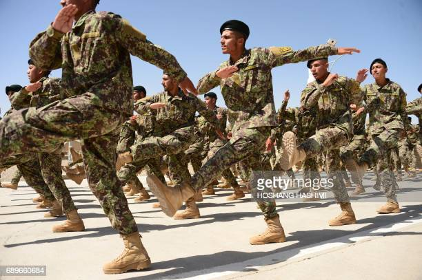 Afghan National Army soldiers march during a ceremony for the completion of their training at a military base in Herat on May 29 2017 Around 800...