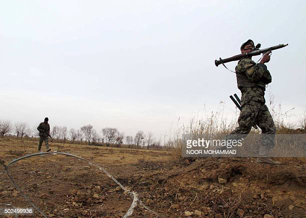 Afghan National Army soldiers patrol during an operation against Taliban militants in the Nad Ali district of Helmand on December 26 2015 Afghan...