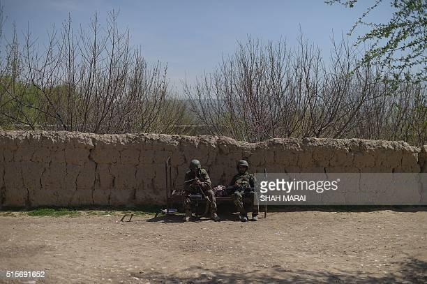 Afghan National Army soldiers rest in DandeGhori district in Baghlan province on March 15 following weeks of heavy battles to recapture the area from...