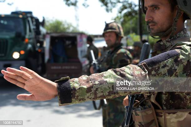 Afghan National Army soldiers search vehicles at a checkpoint in the city of Jalalabad on August 1 2018 Afghanistan ramped up security in Jalalabad...