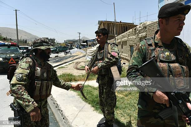 Afghan National Army soldiers stand alert at the site of a bomb blast that targeted NATO forces in Kabul on July 7 2015 A bomb blast targeted NATO...