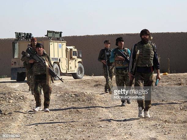 Afghan National Army soldiers walk in Helmand on December 21 2015 Clashes intensified on December 21 as the Taliban pressed an offensive to capture a...