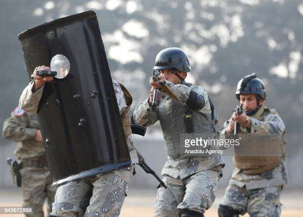 Afghan National Civil Order Police members are seen as they are being received urban warfare training from members of Turkish Armed Forces on January...