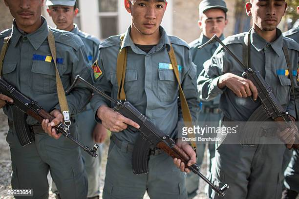 Afghan National Police hold Kalashnikov rifles stand in line at the Kabul Police Academy on November 14 2012 in Kabul Afghanistan Afghan's security...