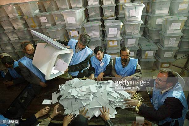 Afghan officials count the ballots at the Darul Aman counting center October 16, 2004 in Kabul, Afghanistan. Early results has President Hamid Karzai...