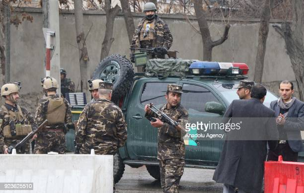 Afghan officials inspect the site after a suicide bomb attack in the Shash Darak area of Kabul near NATO headquarters and not far from the US Embassy...