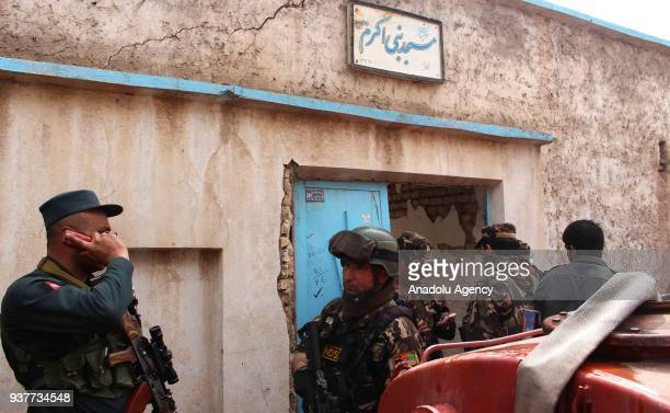 Afghan officials inspect the site of a suicide bomb attack inside the Nabi Akram Mosque in western Herat province of Afghanistan on March 25 2018 A...