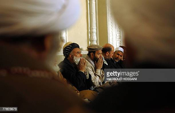 Afghan oficials pray during a prayer service for the victims of the 06 November suicide blast at the Eid Gah mosque in Kabul 09 November 2007 A...