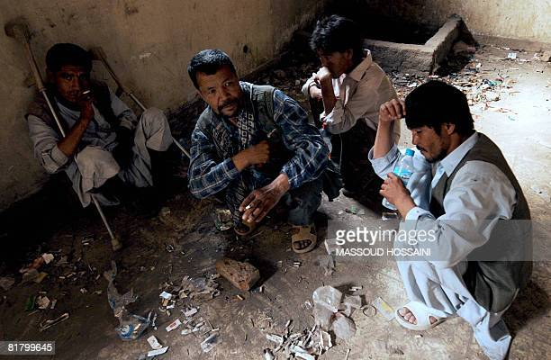 Afghan opium addicts gather inside a destroyed building in Kabul on June 16 2008 Afghanistan is the world's top producer of opium which is also used...