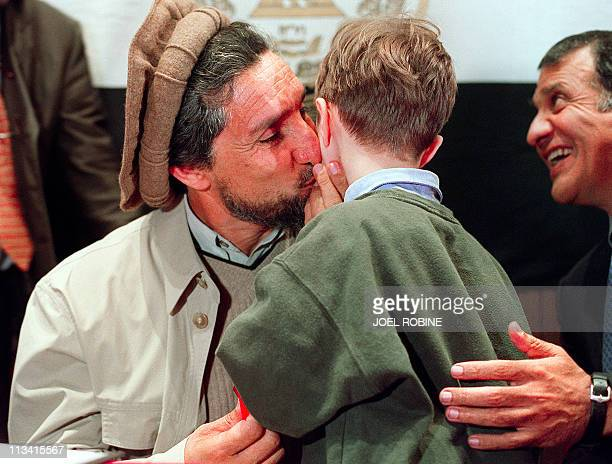 Afghan opposition leader Ahmad Shah Masood kisses Victor Lalonde son of former French Environment Minister Brice Lalonde after a press conference 04...