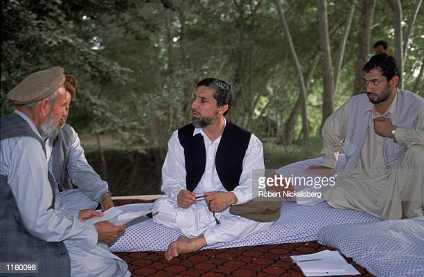 Afghani opposition leader General Ahmed Shah Massoud meets with his advisors at one of his headquarters in Khwaja Bahauddin June 2001 Badakhshan...