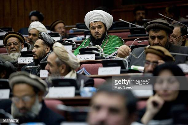 Afghan parliament members attend a voting session on the cabinet on January 2 2010 in Kabul Afghanistan The Afghan parliament began voting today on...