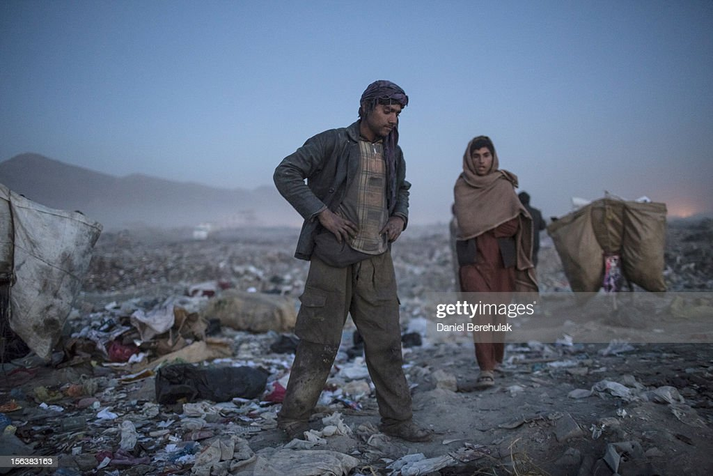 Afghan Pashtun boys, who say they were forced from their troubled province of Baglan due to threats from the Taliban, wind up and collect their takings for the day after scavenging for recycleables at a garbage dump site on November 14, 2012 in Kabul, Afghanistan. Children working at the garbage site in Kabul said they can make up to 90 Afghans (USD $1.75) per day collecting cans and other recyclable materials for sale. If they were to stay and work in their home province, with limited options for employment, and join the Police or Army, the Taliban threatened they would come for them and their families, they said.