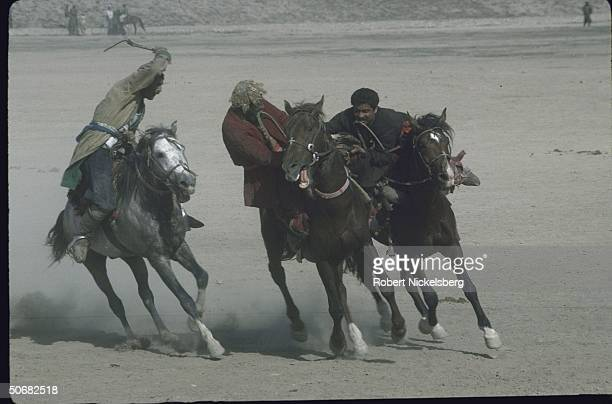 Afghan Pathan men engaging in rough looking competitive horseback riding game