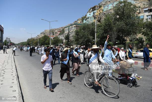 Afghan peace activists march in demand to an end to the war from Helmand as they arrive in Kabul on June 18 2018 Dozens of peace protesters arrived...