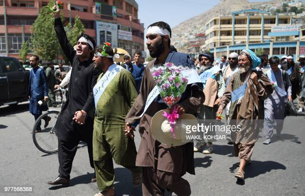 Afghan peace activists shout slogans in demand to an end to the war during a march from Helmand as they arrive in Kabul on June 18 2018 Dozens of...