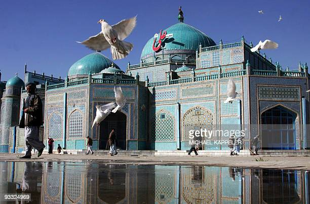 Afghan people are seen in front of the shrine of HazratiAli also called the Blue Mosque in MazariSharif the capital of Balkh province north of Kabul...