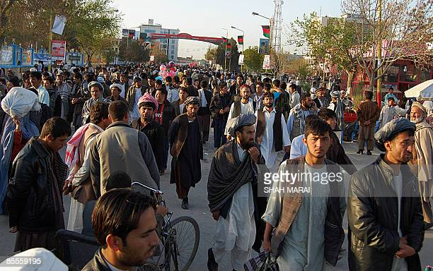 Afghan people arrive to celebrate the New Year at the Hazrat Ali Shrine in the northern town of MazariSharif in Balkh province on March 20 2009 Tens...