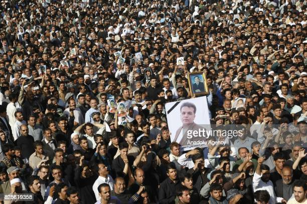 Afghan people gather to stage a demonstration against Afghan Government due to increasing security issues as they carry photographs those who lost...