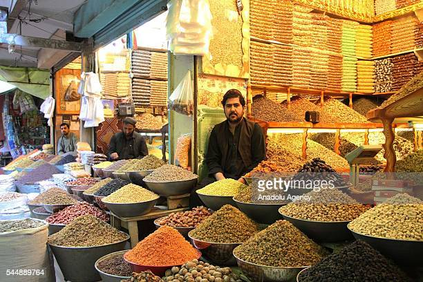 Afghan people shop at local bazaar ahead of Eid alFitr the celebrations marking the end of the Muslims' holy fasting month Ramadan in Kabul...