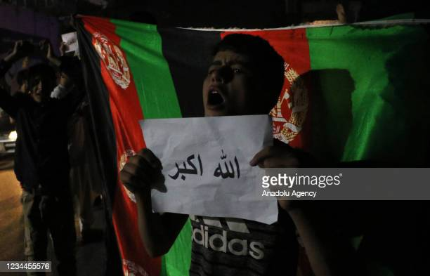 Afghan people shout slogans against the bomb attack as they gather on the streets of Kabul, Aghanistan on August 03, 2021. Thousands Afghan chanting...