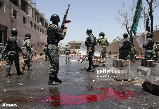 Afghan police clash with protesters during a protest against a suicide bomb attack in Kabul Afghanistan on June 2 2017 At least six protesters were...