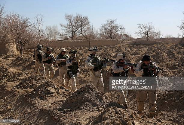 Afghan police forces patrol during an antiTaliban operation in the Andar district of Ghazni province on February 4 2015 Afghan police forces launched...