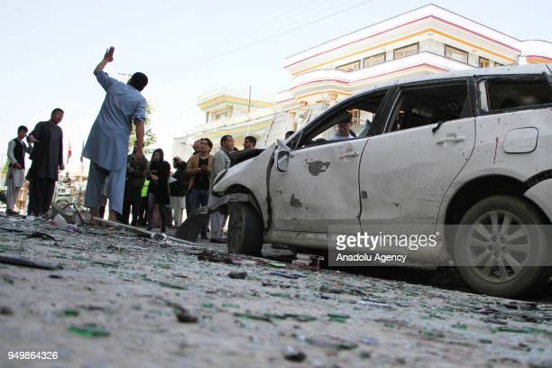 Afghan police officers inspect the scene of a suicide bomb attack that targeted a voter registration center in Kabul Afghanistan on April 22 2018 At...