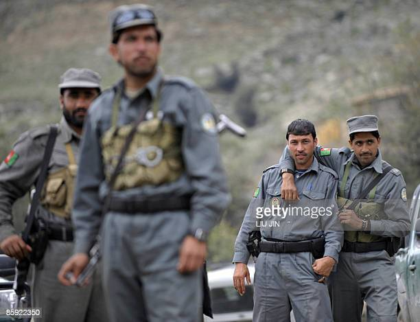 Afghan policemen are pictured at a police station in Naray, in Afghanistan's eastern Kunar province on April 13, 2009. US President Barack Obama,...